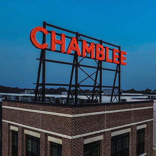Olmstead Chamblee neon rooftop sign illuminated red neon at night