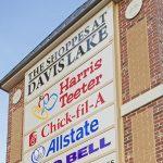 Shoppes at Davis Lake pylon sign with tenant panels and brick masonry