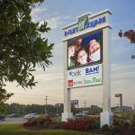 Inlet Square shopping center pylon sign with watchfire emc on the side of the road