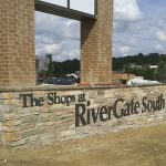 Routed letters installed on masonry of shopping center pylon sign