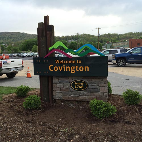 Monument sign with railroad ties and masonry in parking lot in Covington VA
