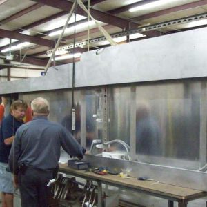 Rite Lite technicians assemble metal pieces together for Isis Music Hall custom marquee canopy at production facility
