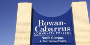 White bricks of the Rowan Cabarrus Community College pylon sign without top logo