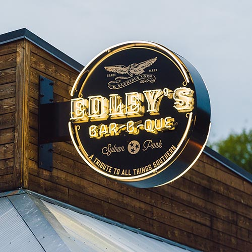 Close up of custom neon sign for Edley's BBQ Restaurant in Nashville TN