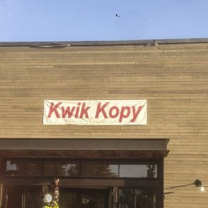 Banner sign before sign installation for Kwik Kopy
