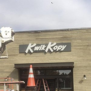 Rite Lite installation of Kwik Kopy wall sign in Huntersville, NC