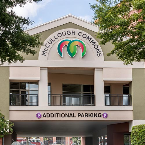 McCullough Commons shopping center logo installed on colorful building