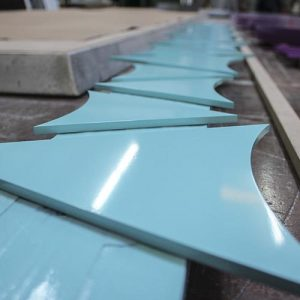Lite blue painted aluminum arrows for directional sign for McCullough Commons shopping center