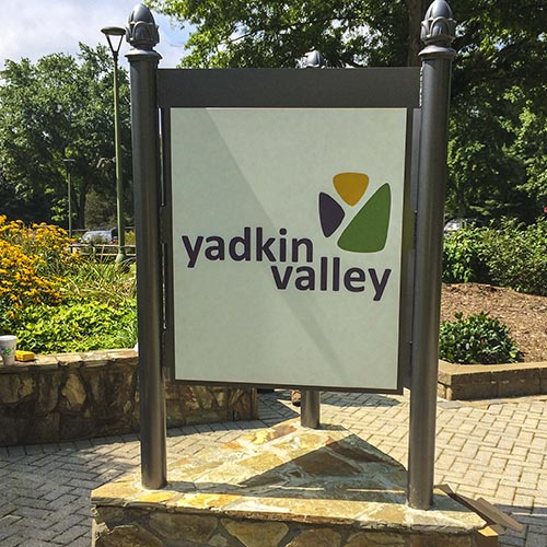 Triangular shaped wayfinding and directional sign for yadkin valley