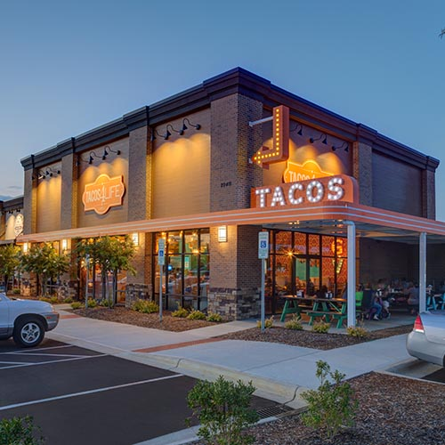 Custom fabricated signs for Tacos 4 Life restaurant building by Rite Lite