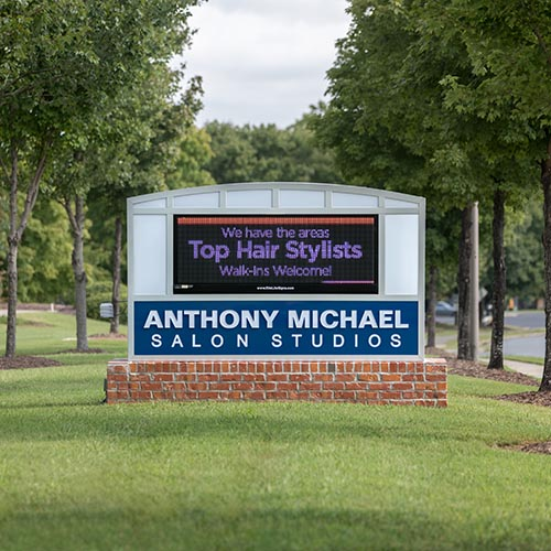 Custom monument sign for Anthony Michael Salon Studios retail business with Watchfire Electronic Message Center