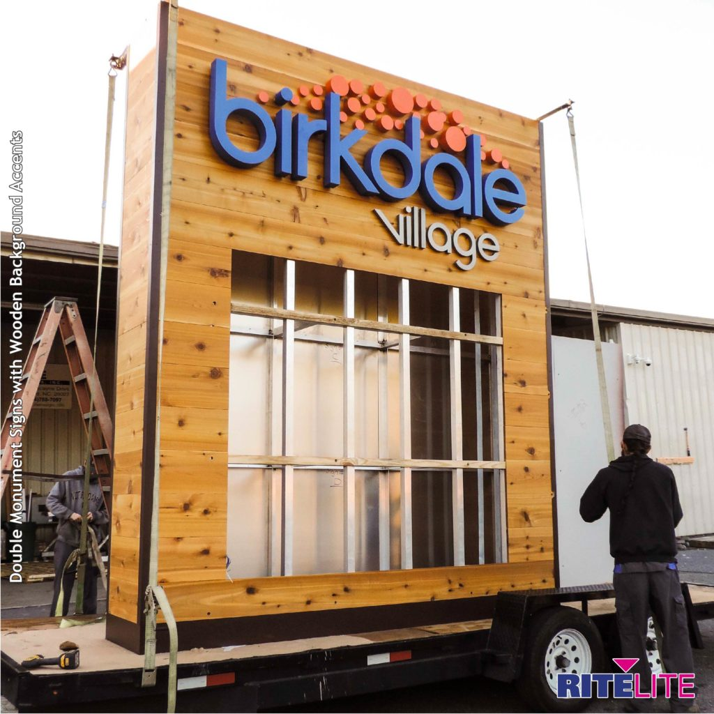 Birkdale village wooden monument sign being loaded onto a flatbed