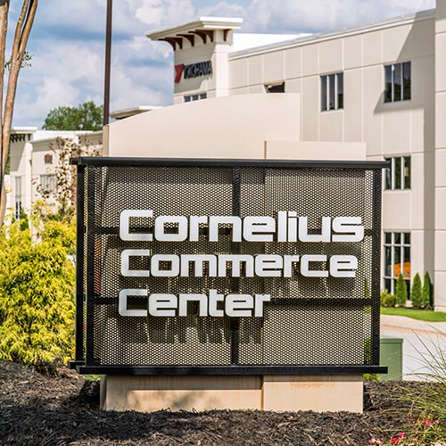 Internally-illuminated trimless channel letters with perforated metal panels monument sign for Cornelius Commerce Center corporate park