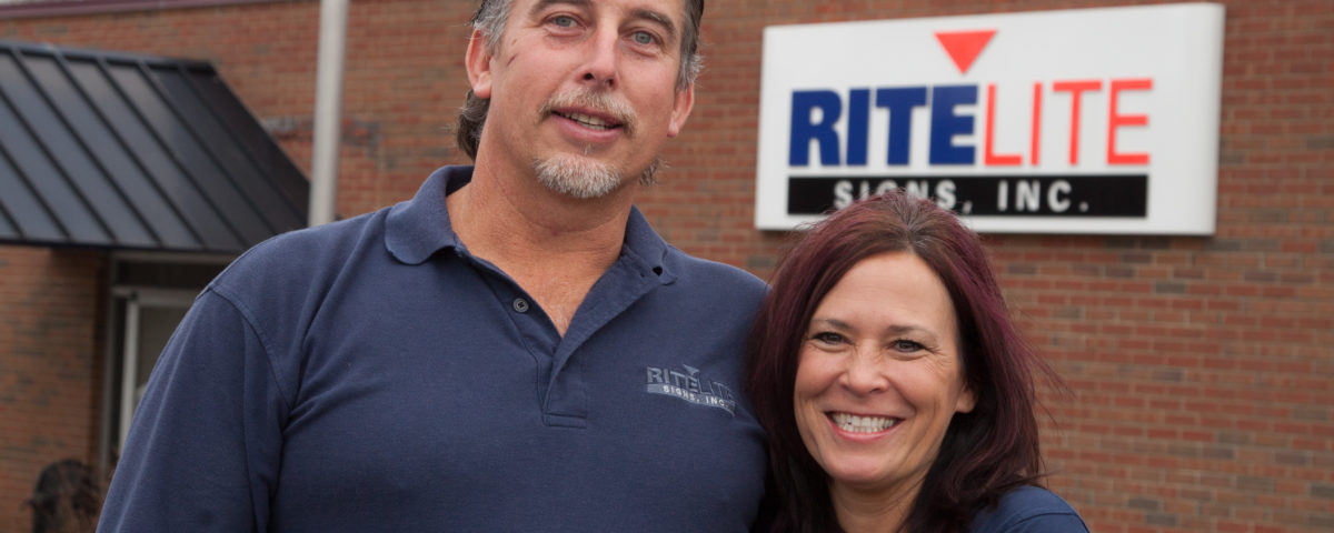 Tasha and David Catchpole standing in front of Rite Lite Signs