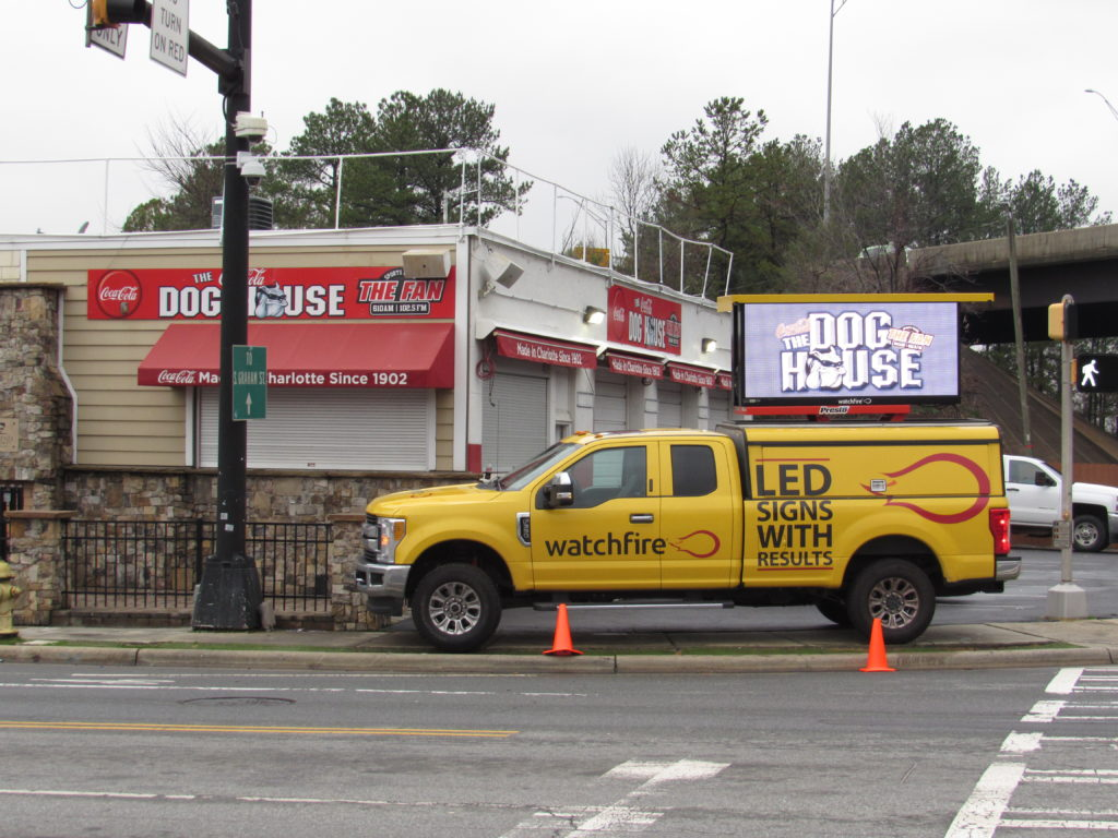 Yellow Watchfire Signs truck giving an EMC demo on location at The Dog House in Uptown Charlotte!