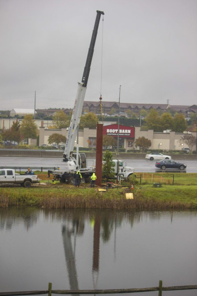 Rite Lite Installation crew operating large crane and installing large steel support for sign in the rain