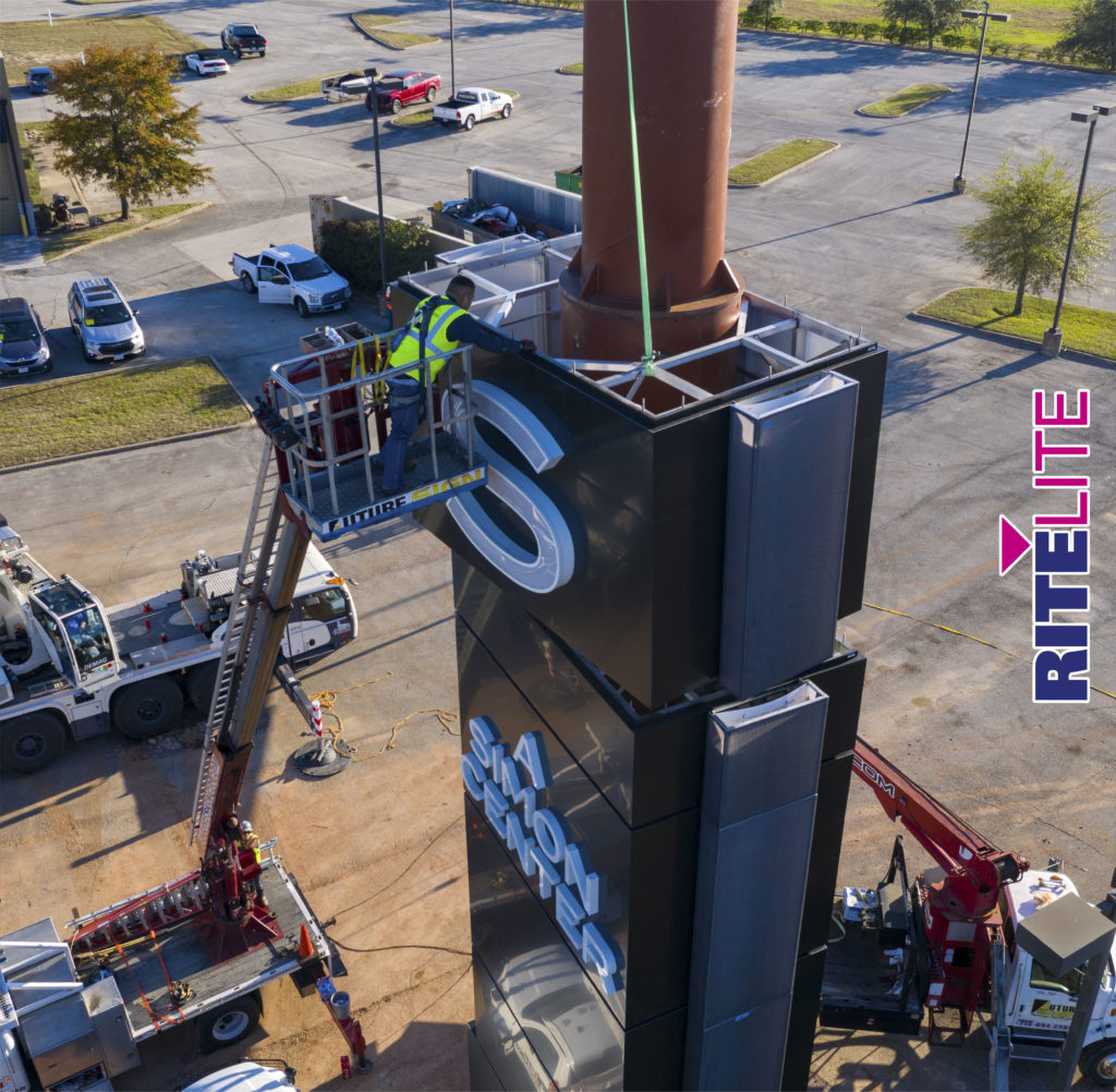Aerial shot of installer assembling a section on the Katy Mills pylon sign