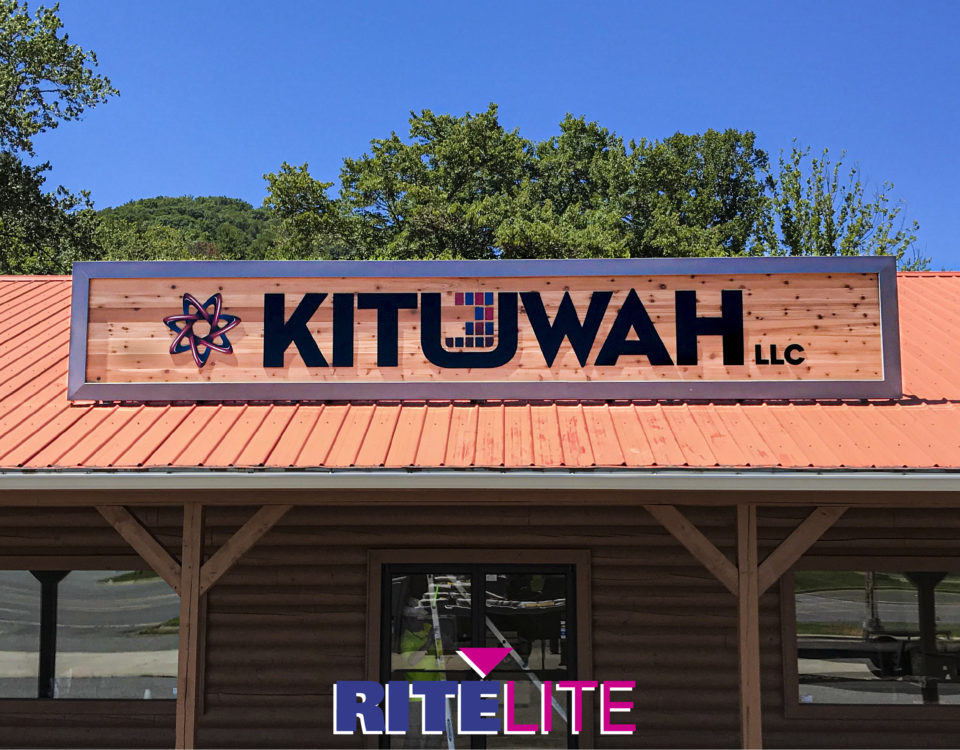 Large wooden faced wall sign mounted to rootfop of Kituwah LLC