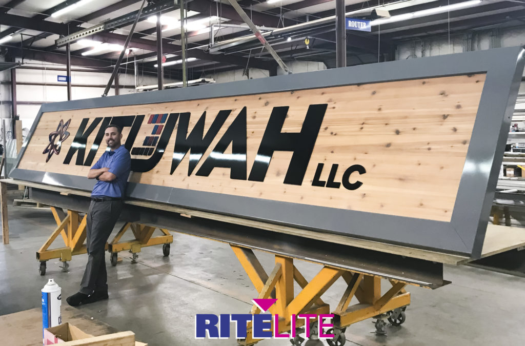 Stephen Parrish shows scale for Kituwah sign in Rite Lite facility.
