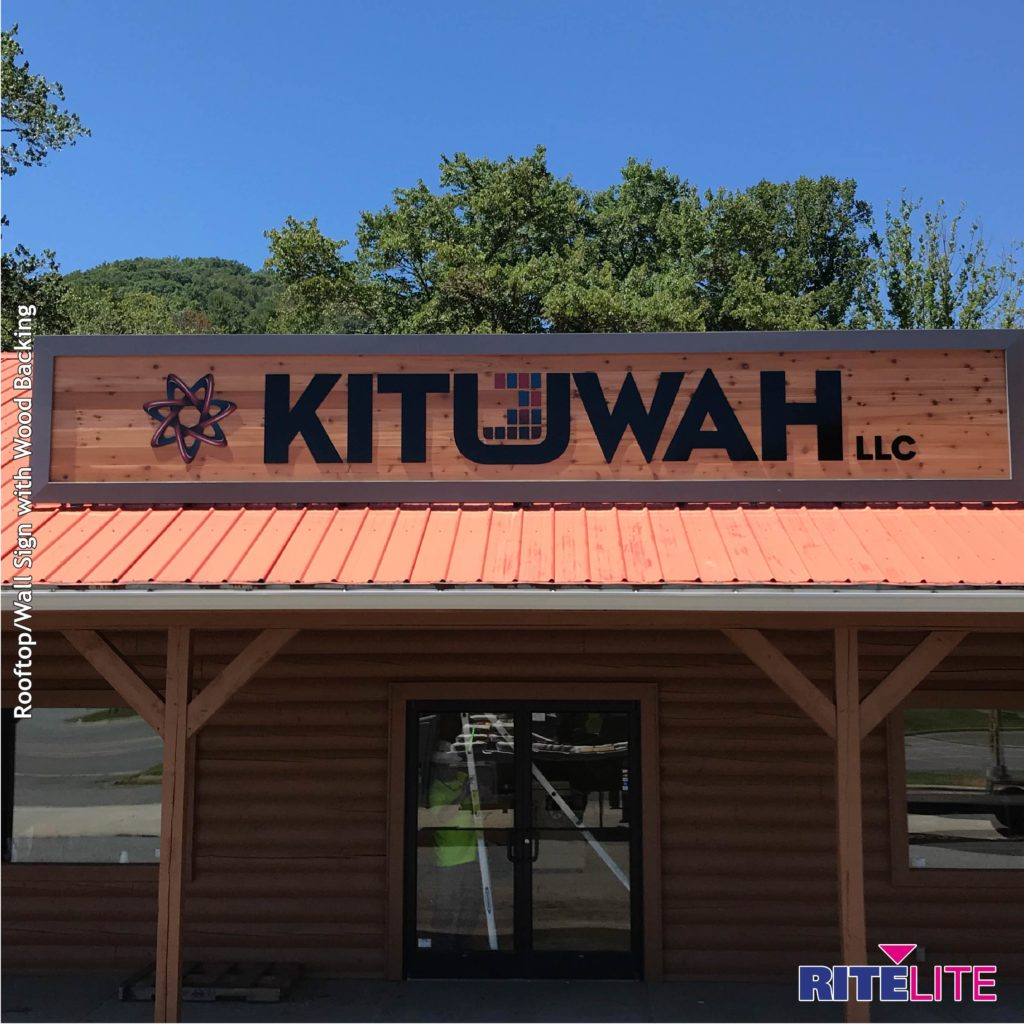 Kituwah rooftop sign with wooden backing