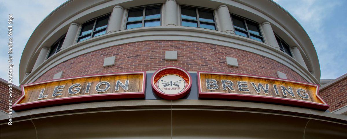 Legion brewery radius sign on brick building entrance