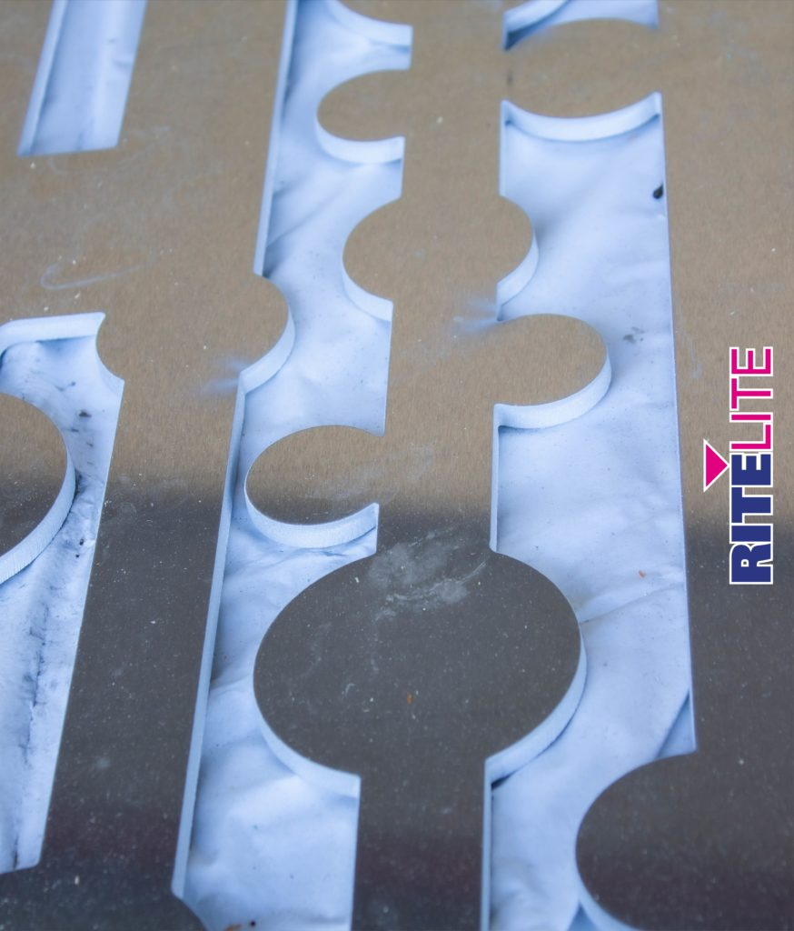 Close up of routed design in a decorative metal fence at Rite Lite warehouse