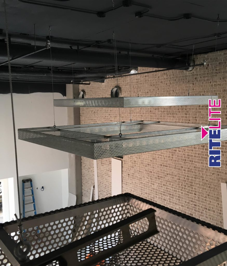 Installation of metal ceiling pieces at Novel Noda