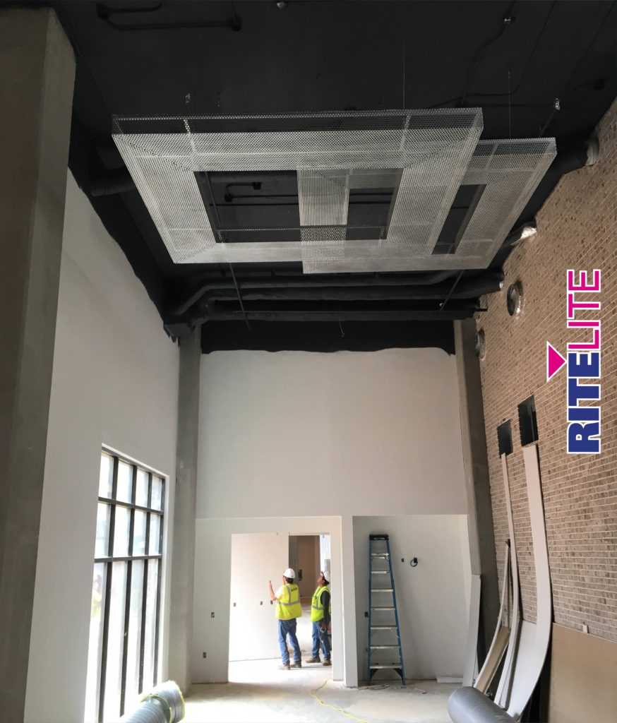 Installation of ceiling metal art pieces by Rite Lite for Novel Noda