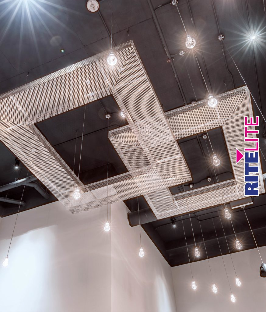 Lights hanging from metal ceiling art at Novel Noda from Rite Lite