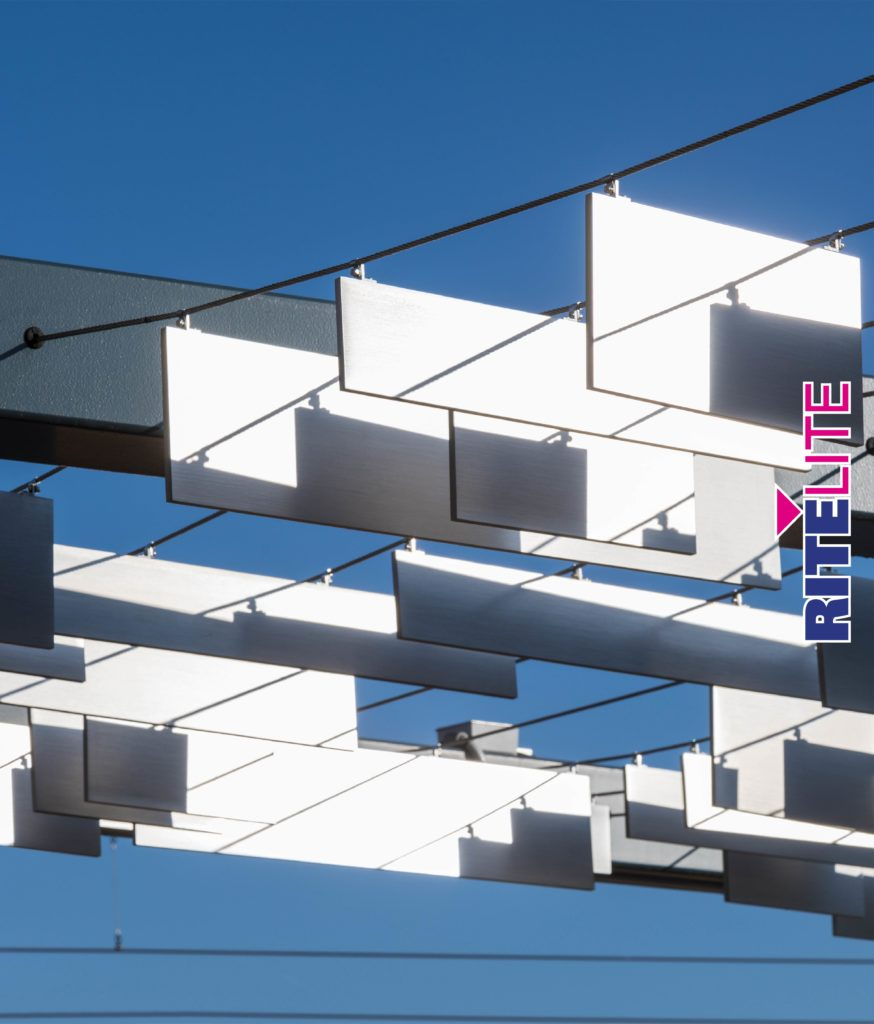 Metal panels hanging from tensioned wire in metal trellis at Novel Noda by Rite Lite