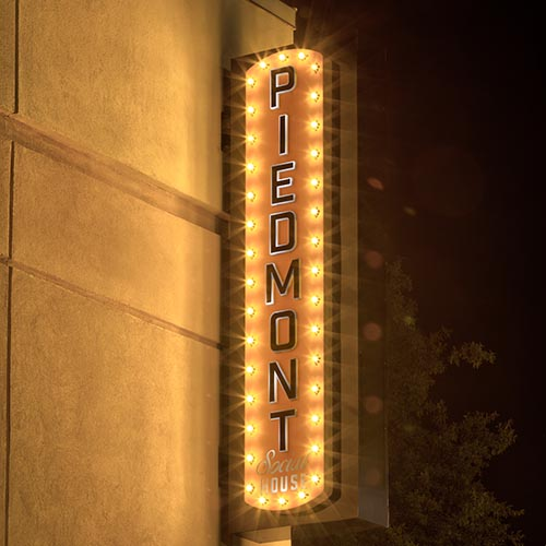 Custom blade sign with marquee accent lighting for Piedmont Social House bar and restaurant in Charlotte NC