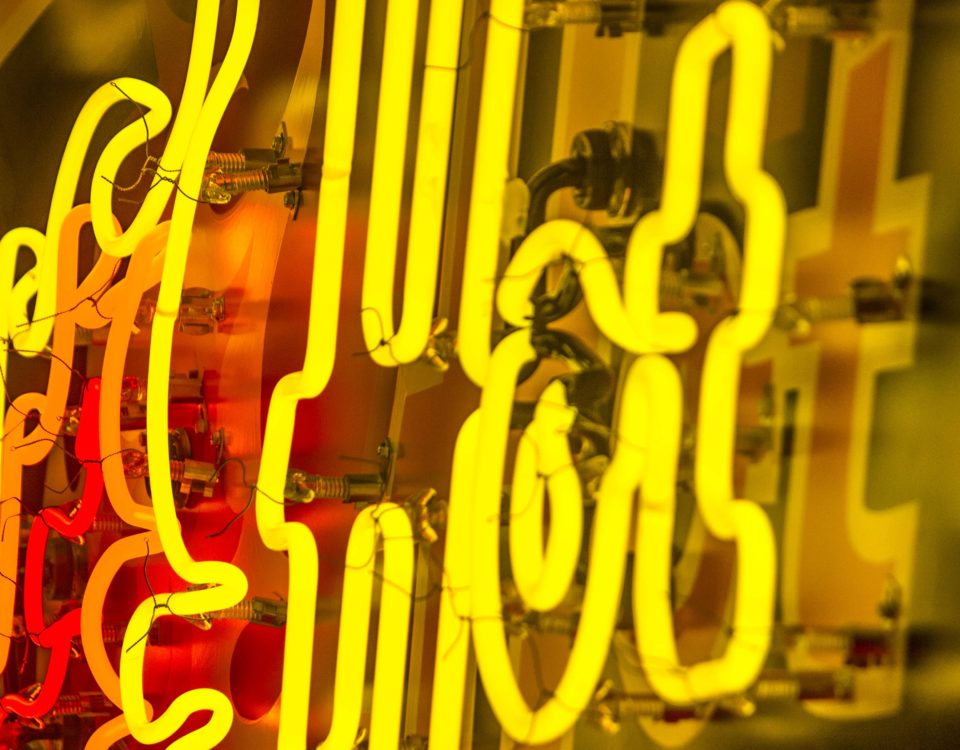 "Close up of illuminated yellow neon reading ""HOT"""