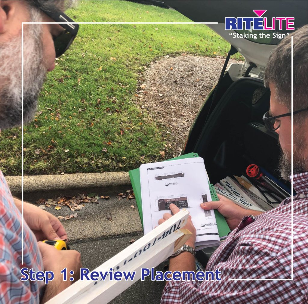 Rite Lite employee reviewing sign placement
