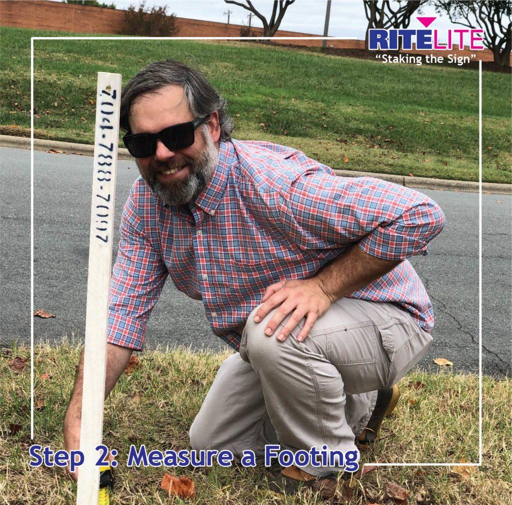 Rite Lite employee measuring for stake installs