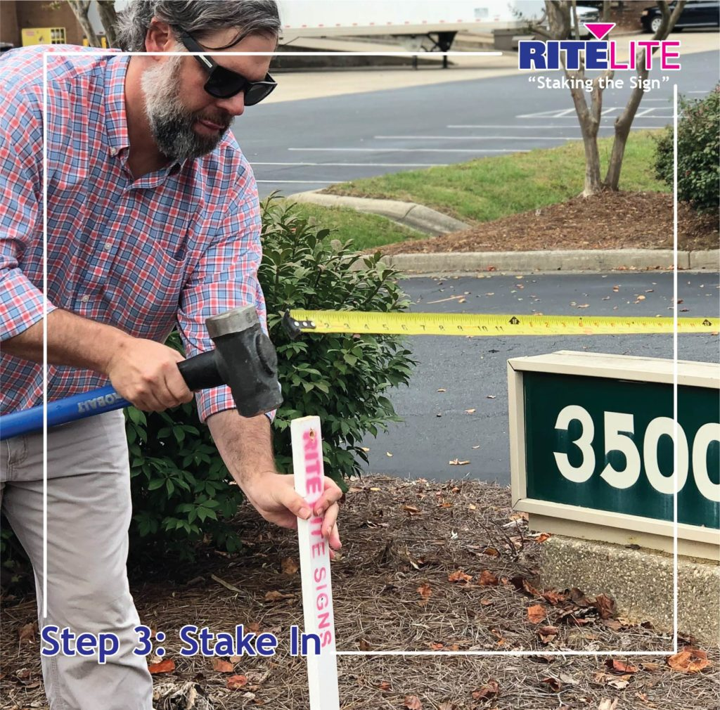 Rite Lite employee hammering in a stake
